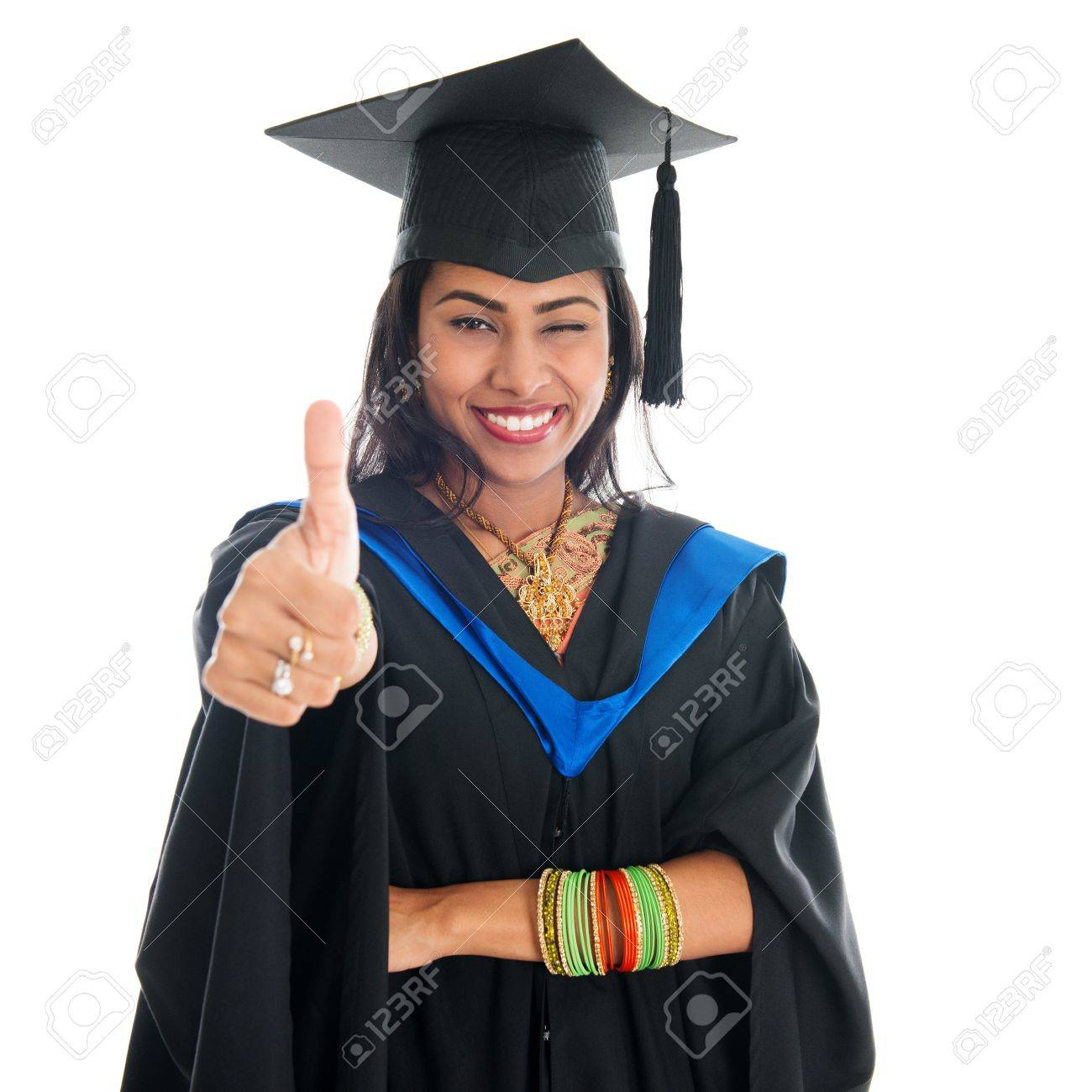 Happy Indian Graduate Student In Graduation Gown And Cap Giving ...