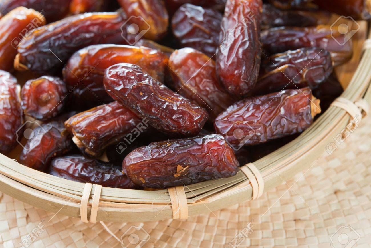 Dates fruit. Pile of fresh dried date fruits in a basket. Stock Photo - 20891483