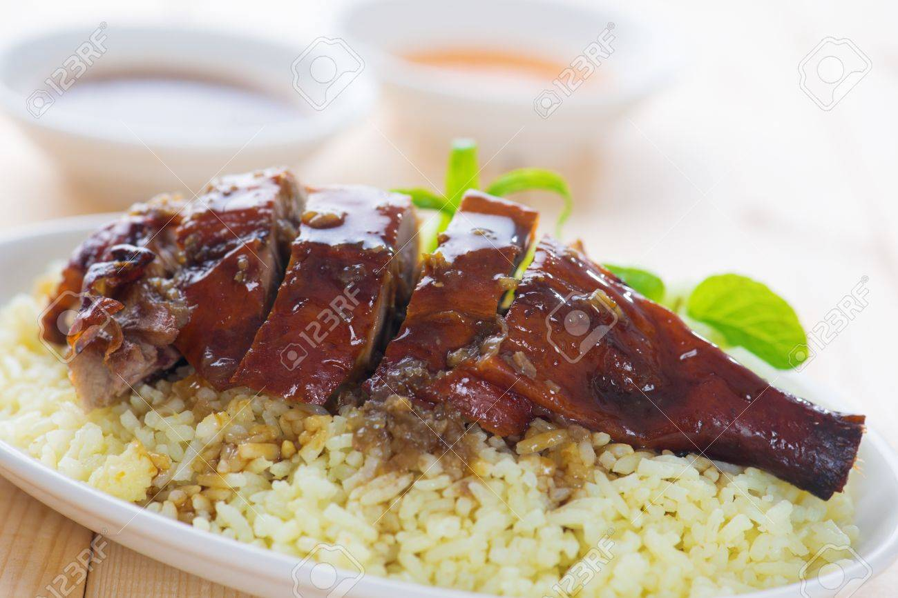 Peking duck or Roasted duck, Chinese style, served with steamed rice on dining table. Hong Kong cuisine. Stock Photo - 21374011