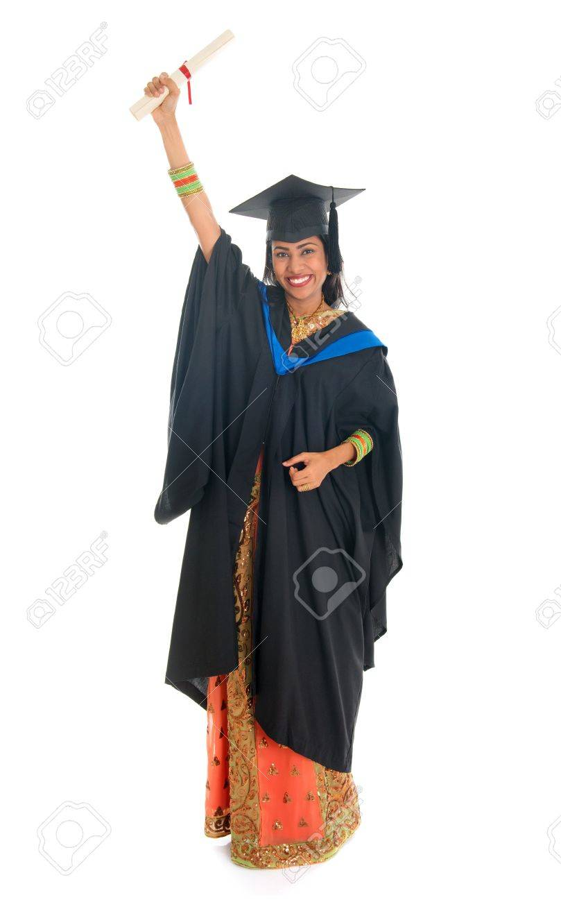 fb028a8a77f Full length happy Indian university student in graduation gown and cap  holding diploma certificate. Portrait