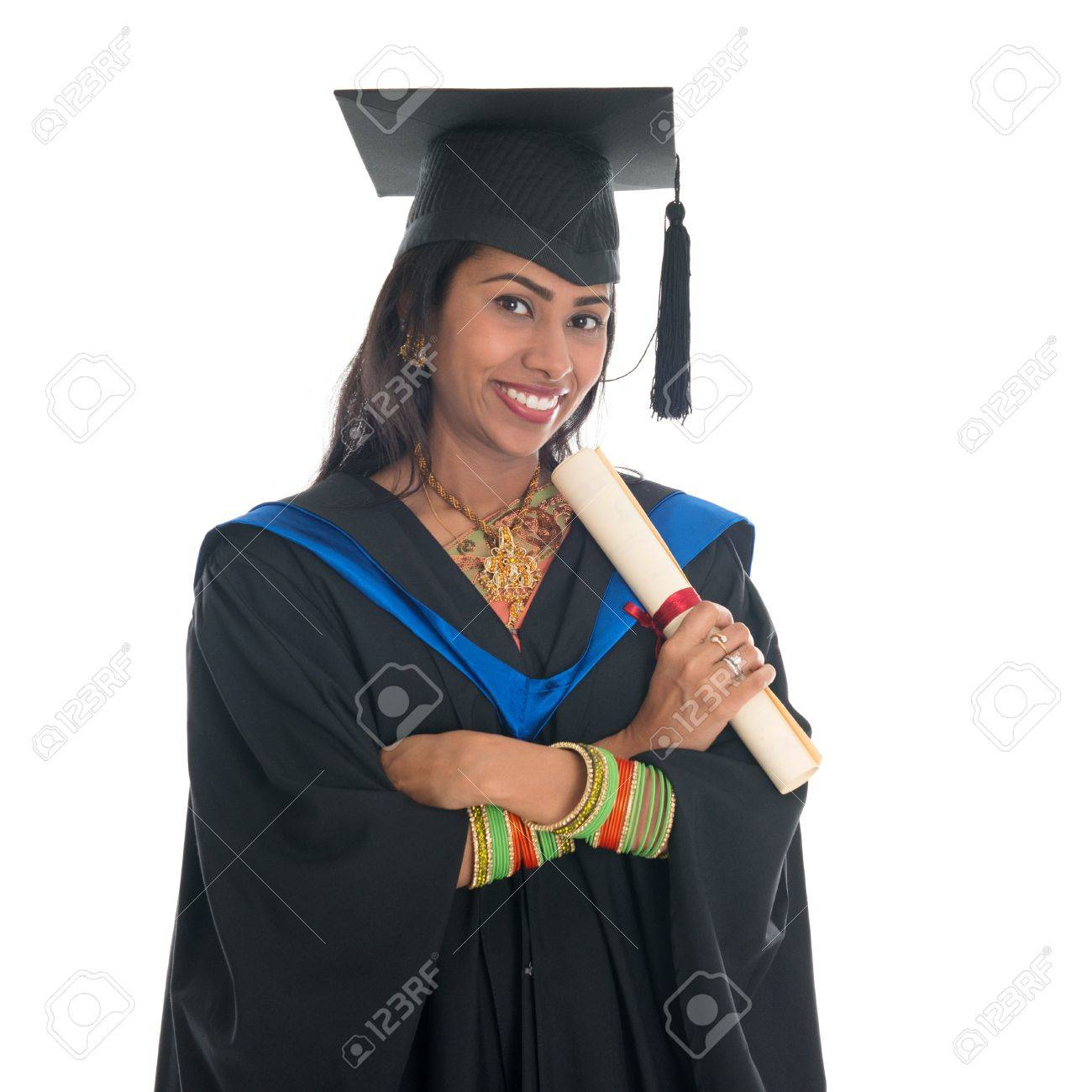 Happy Indian College Student In Graduation Gown And Cap Holding ...