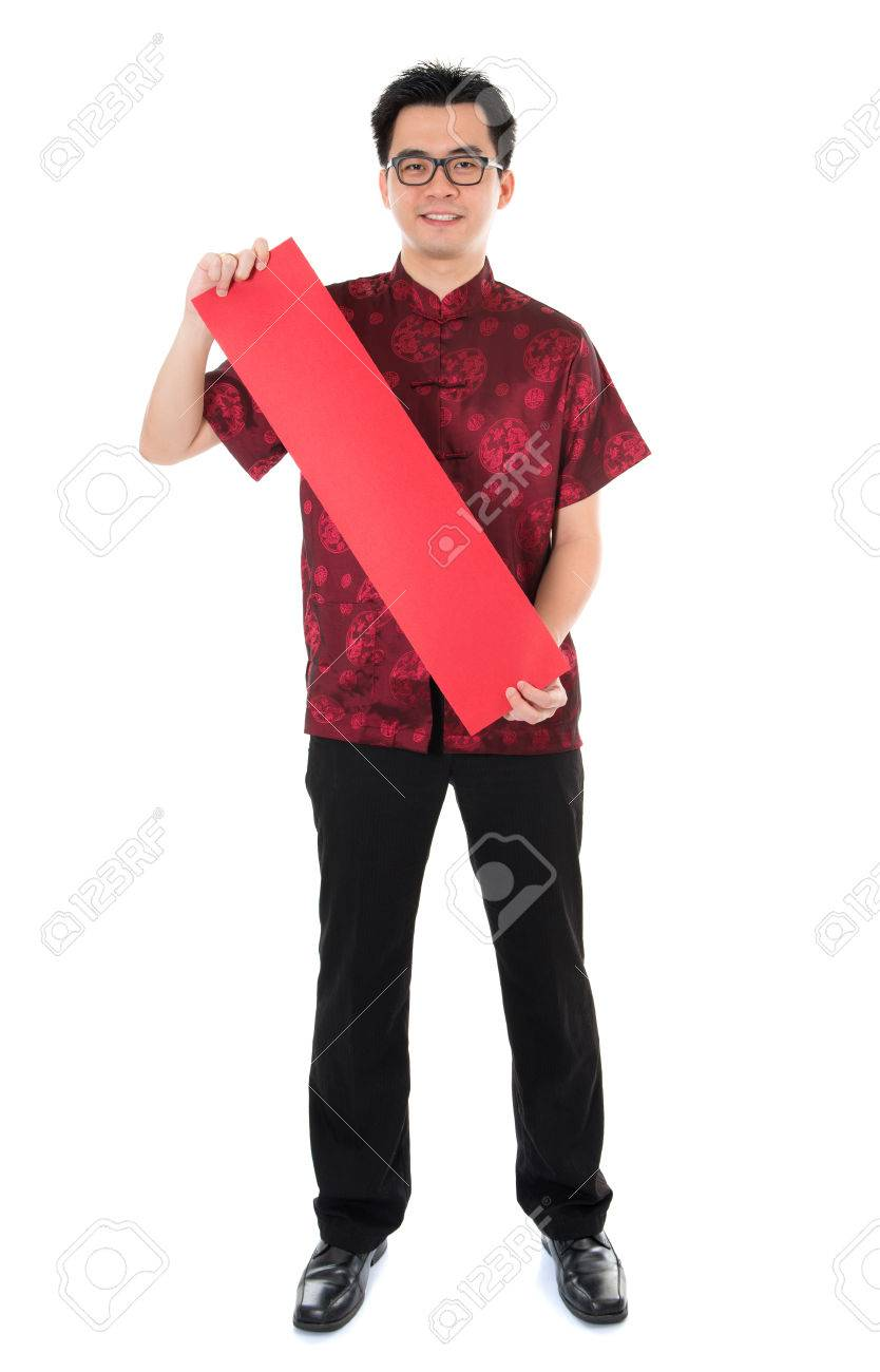 Full length Asian man with Chinese traditional cheongsam or tang suit holding couplet. Male model isolated on white background. Stock Photo - 22284187