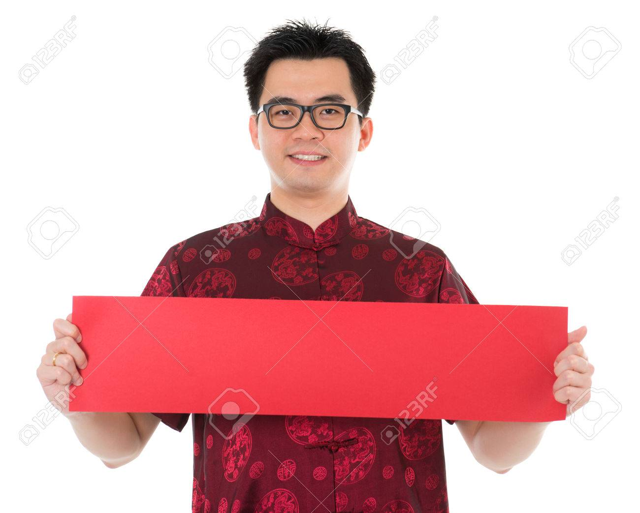 Asian male with Chinese traditional cheongsam or tang suit holding couplet. Male model isolated on white background. Stock Photo - 22284190