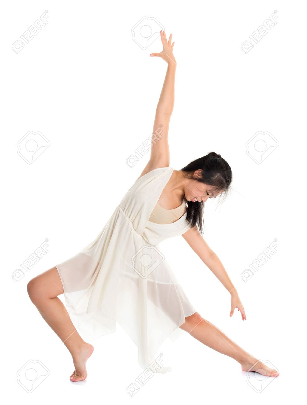 Modern Asian teen contemporary dancer poses in front of the studio background, full length isolated white. - 22284217