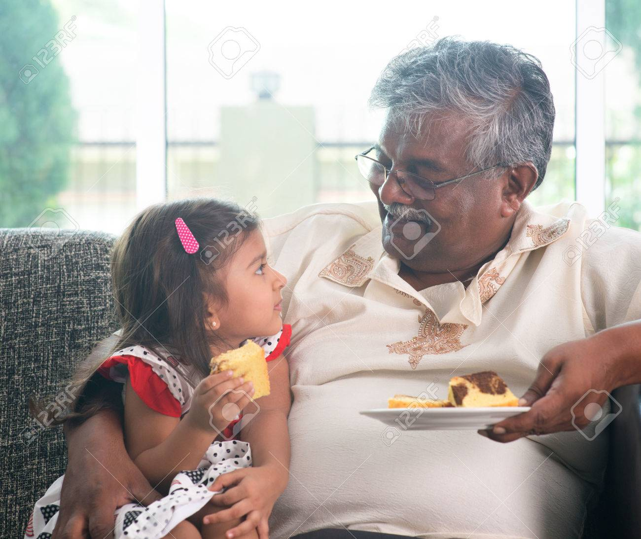 portrait indian family at home grandparent and grandchild eating