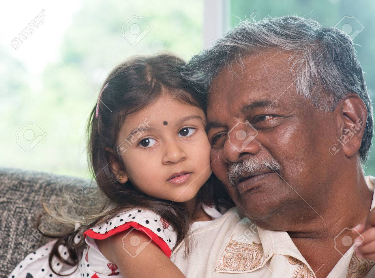 portrait indian family at home grandparent and grandchild close