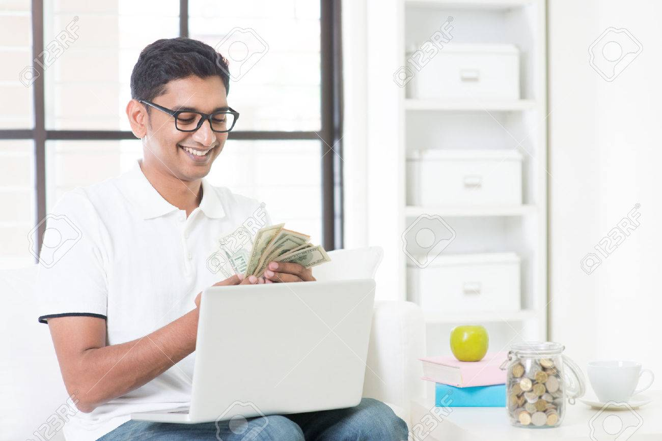 Image result for 40852559-indian-guy-counting-cash-earning-money-from-his-successful-online-business-asian-man-working-from-ho-stock-photo