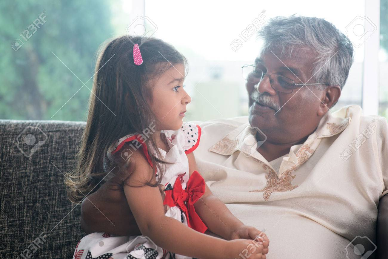 portrait indian family at home grandparent and grandchild talking