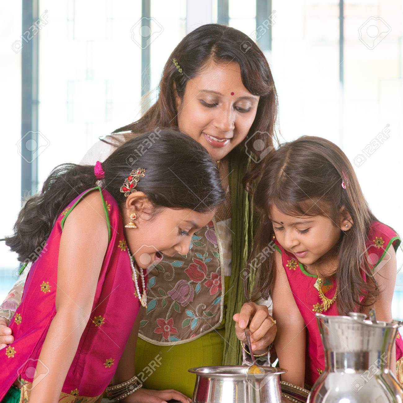 Family cooking kitchen - Asian Family Cooking Food Together In Kitchen Indian Mother And Children Preparing Meal At Home