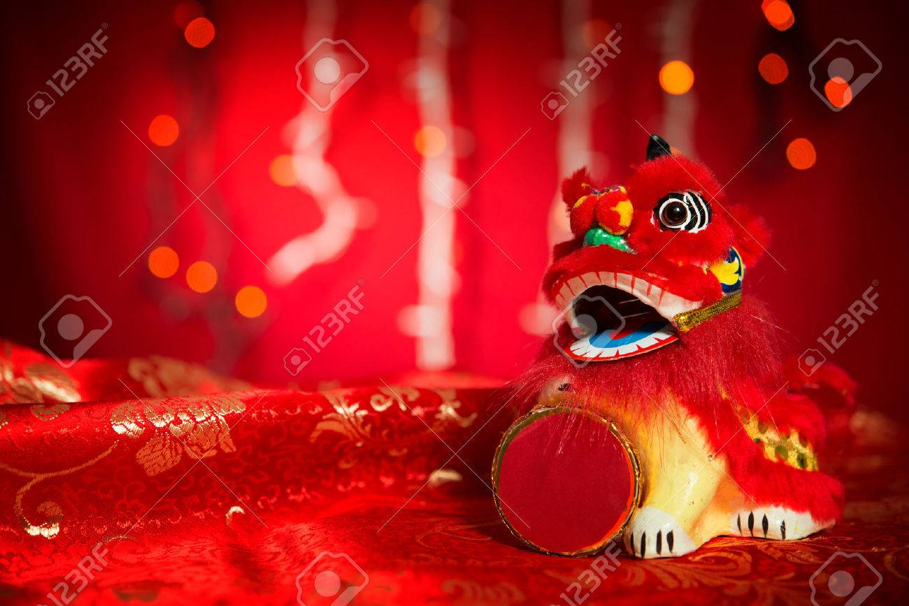 Chinese new year decorations, miniature dancing lion on red glitter background. - 49468144