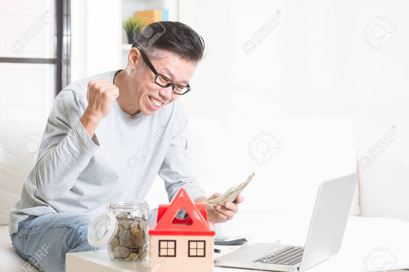 Portrait of happy 50s mature Asian man counting on money and smiling. Saving, retirement, retirees financial planning concept. Family living lifestyle at home. - 51835388