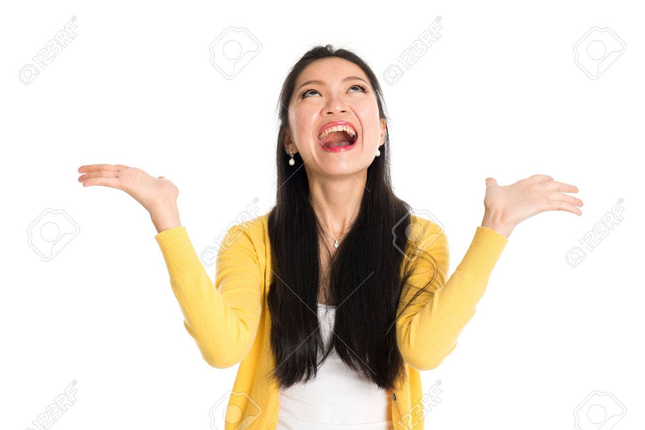 Surprised Asian woman mouth open wide, shouting and looking up, standing isolated on white background. - 69756507
