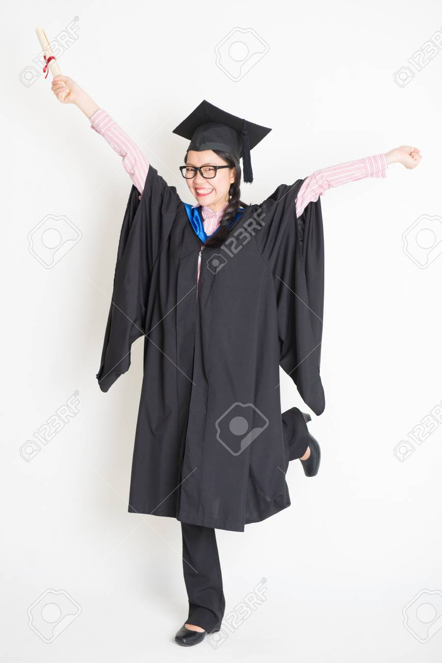 University Student In Graduation Gown And Cap Hand Raised Holding ...