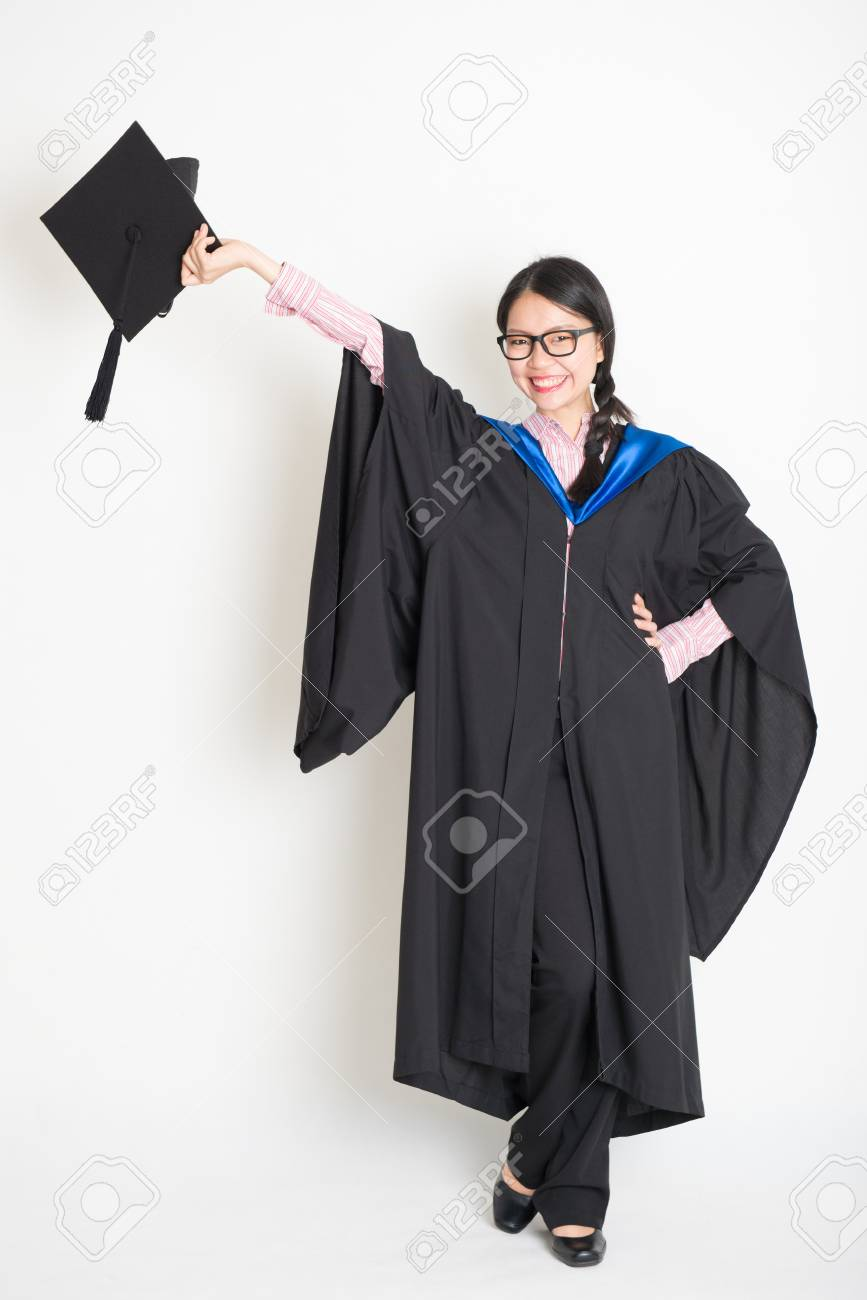 University Student In Graduation Gown Hand Raised Holding ...