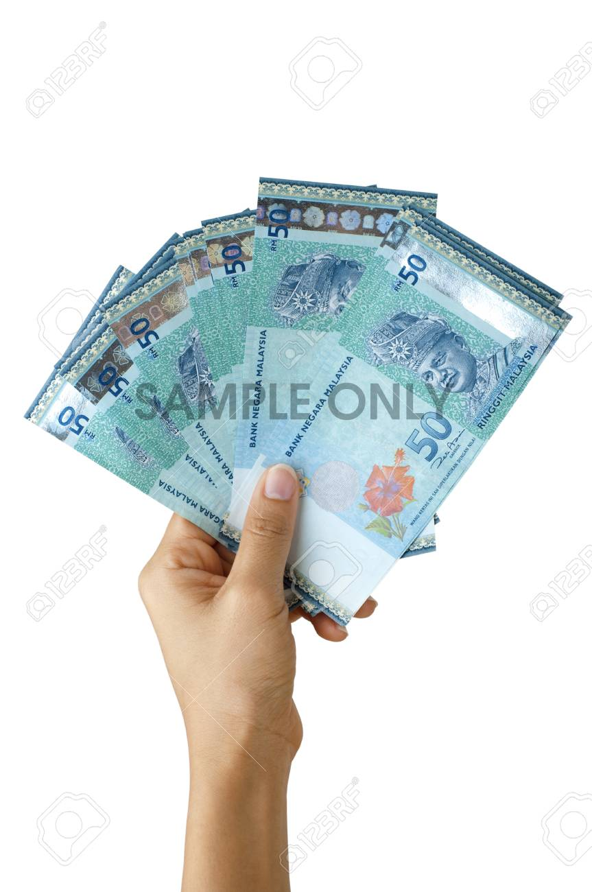 Malaysian currency, hand holding hundreds ringgit Malaysia, isolated on white background. - 81289499