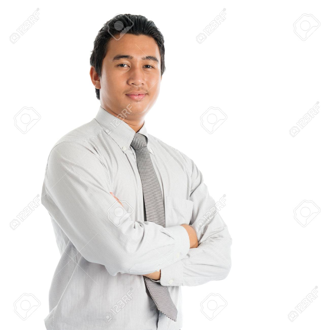 Portrait of cool Southeast Asian businessman arms crossed, standing isolated on white background. - 81888904
