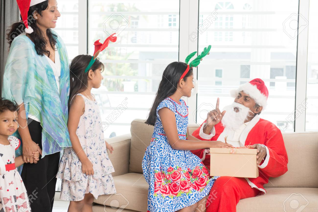 Happy Indian Family Celebrating Christmas Holidays, With Gift ...