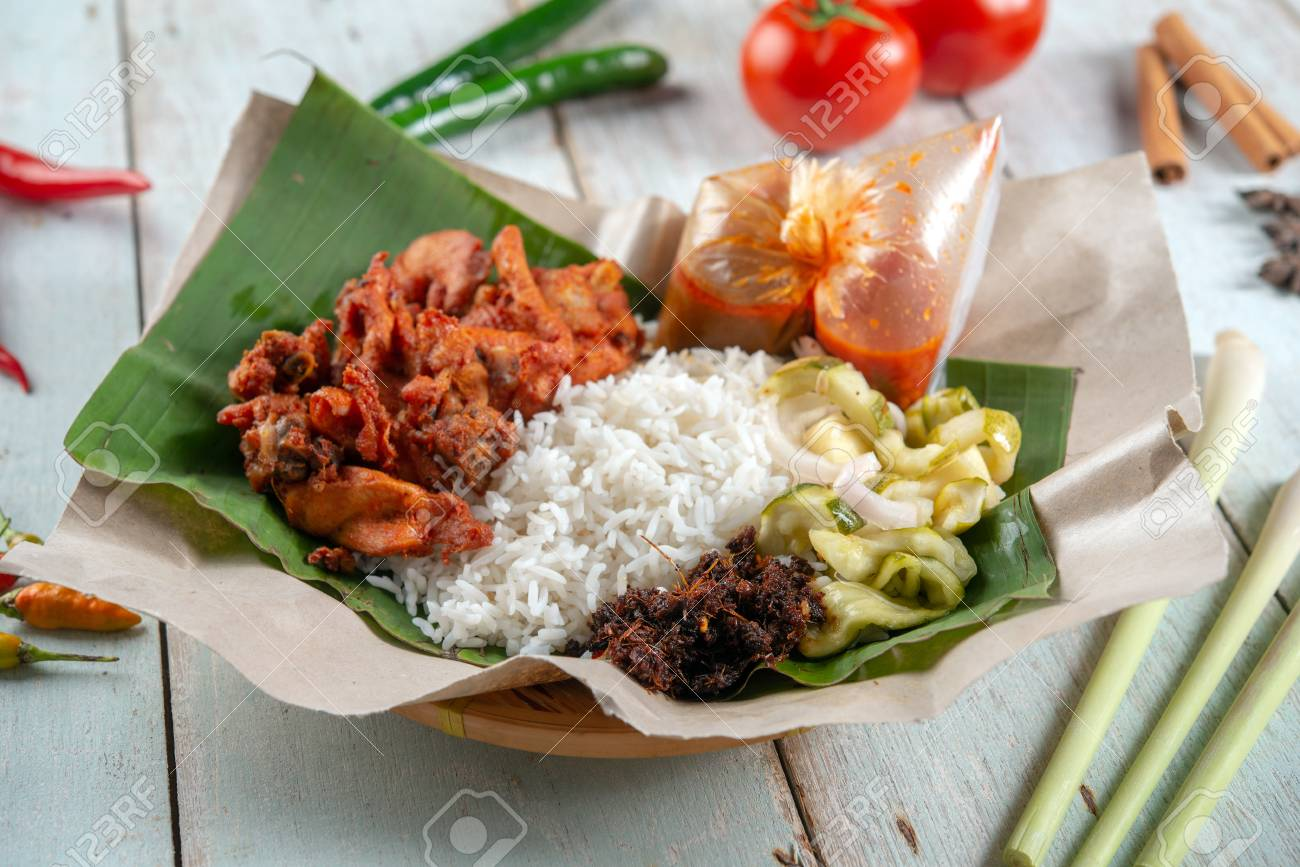 Nasi kukus ayam berempah, popular traditional Malay local food. - 118841460
