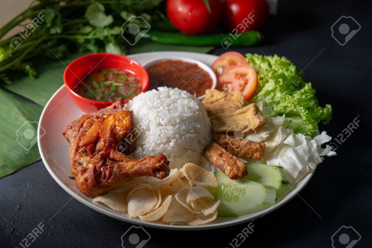 Nasi lemak kukus with fried drumstick, popular traditional Malaysian local food. - 118841418