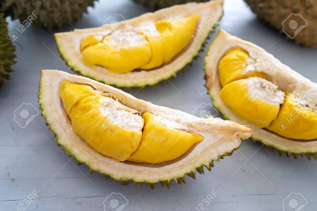 Malaysia famous fruits durian musang king, sweet golden creamy flesh. - 128375212