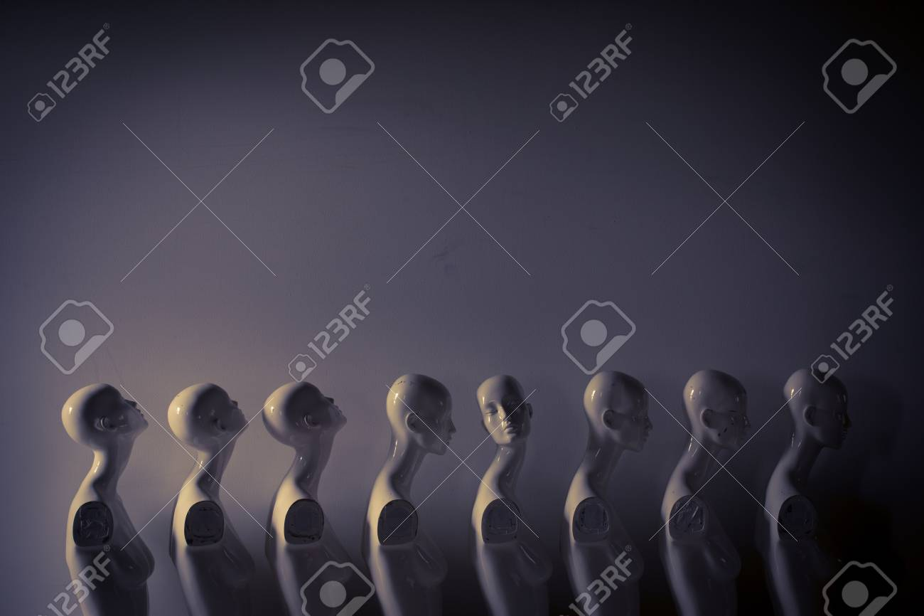 Plastic Woman Mannequins Standing in The Line, With One Looking to Another Direction then the Others in Melancholic Mood - 125136464
