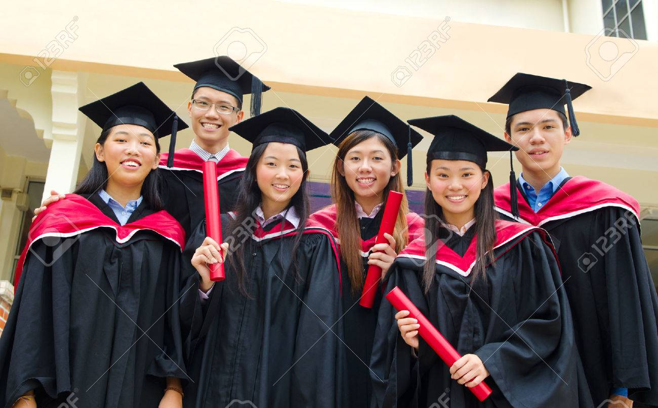 Group Of Asian University Students In Graduation Gown And ...