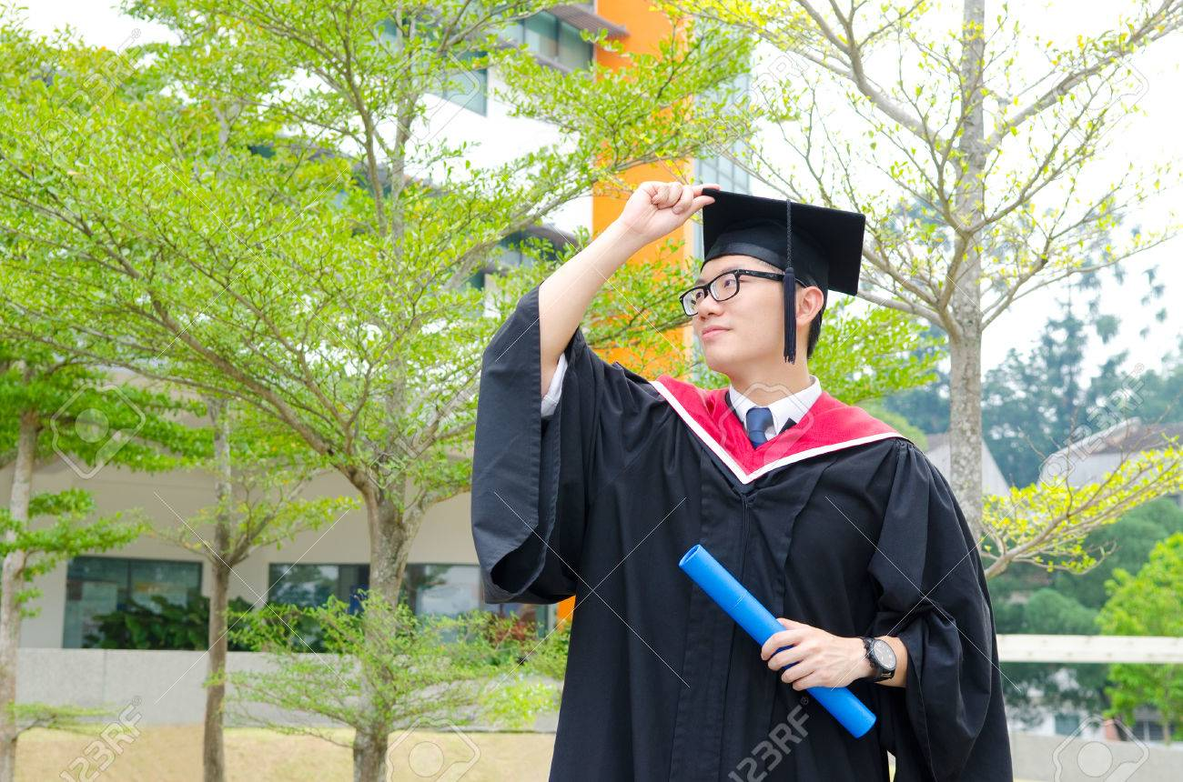 Asian University Student In Graduation Gown And Mortarboard Stock ...