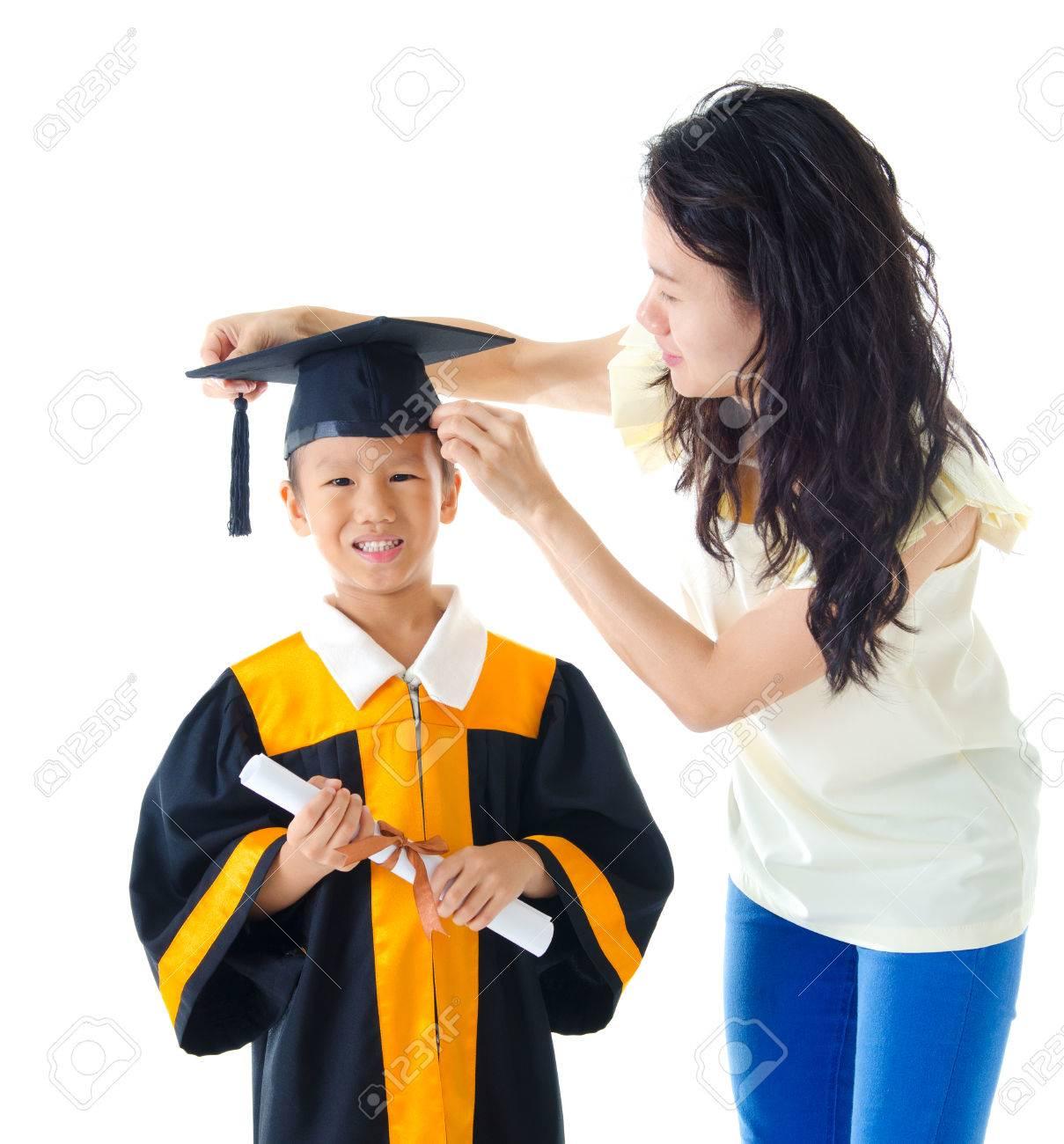 Asian Kindergarten Kid In Graduation Gown And Mortarboard Stock ...