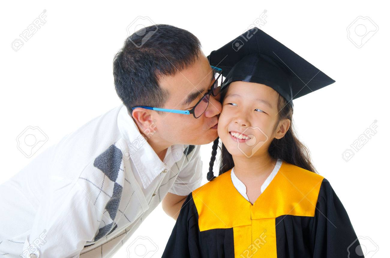 Asian Girl In Graduation Gown Kissed By Her Father Stock Photo ...