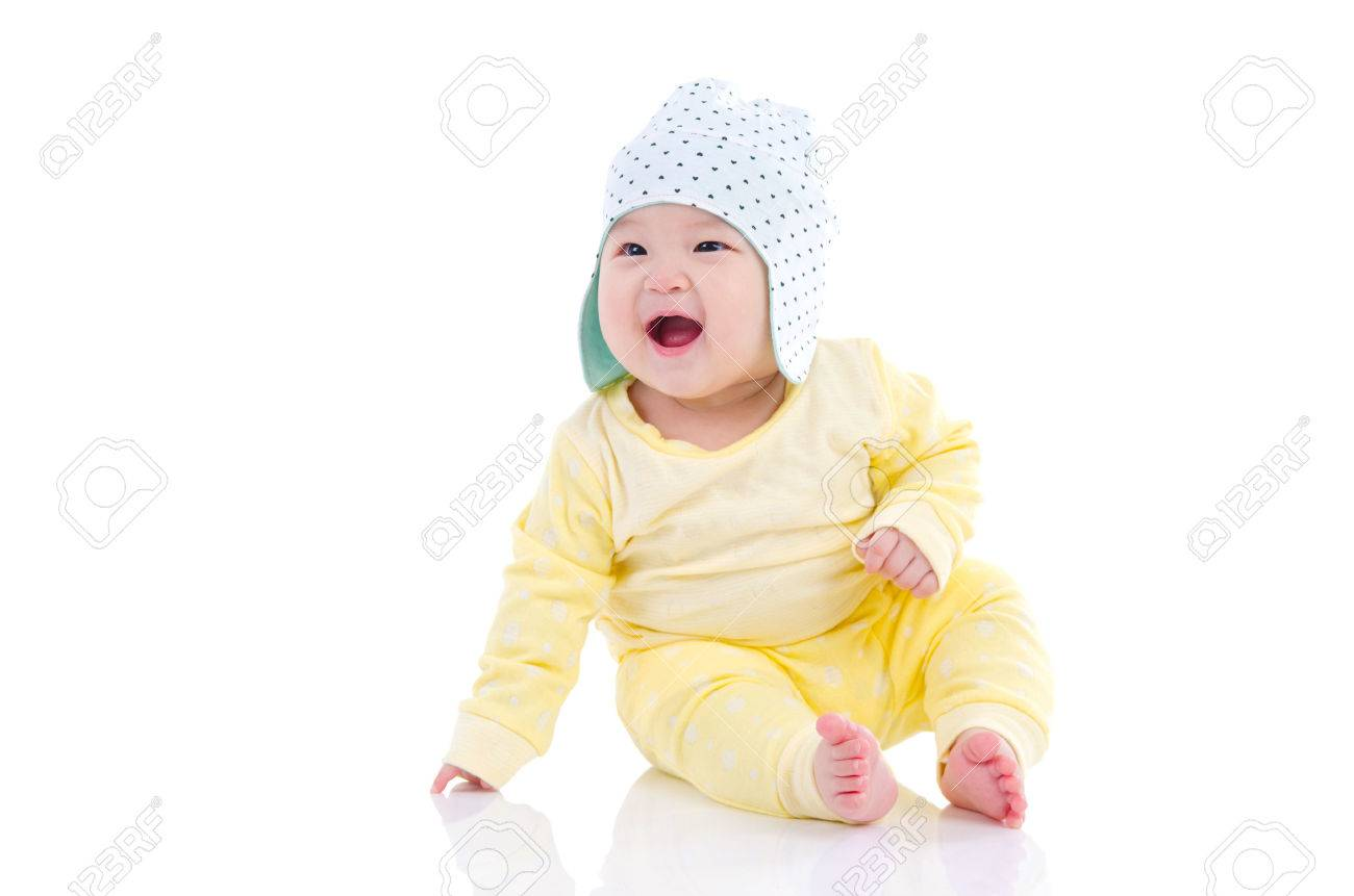 Asian baby sitting on the floor and laugh - 60660087