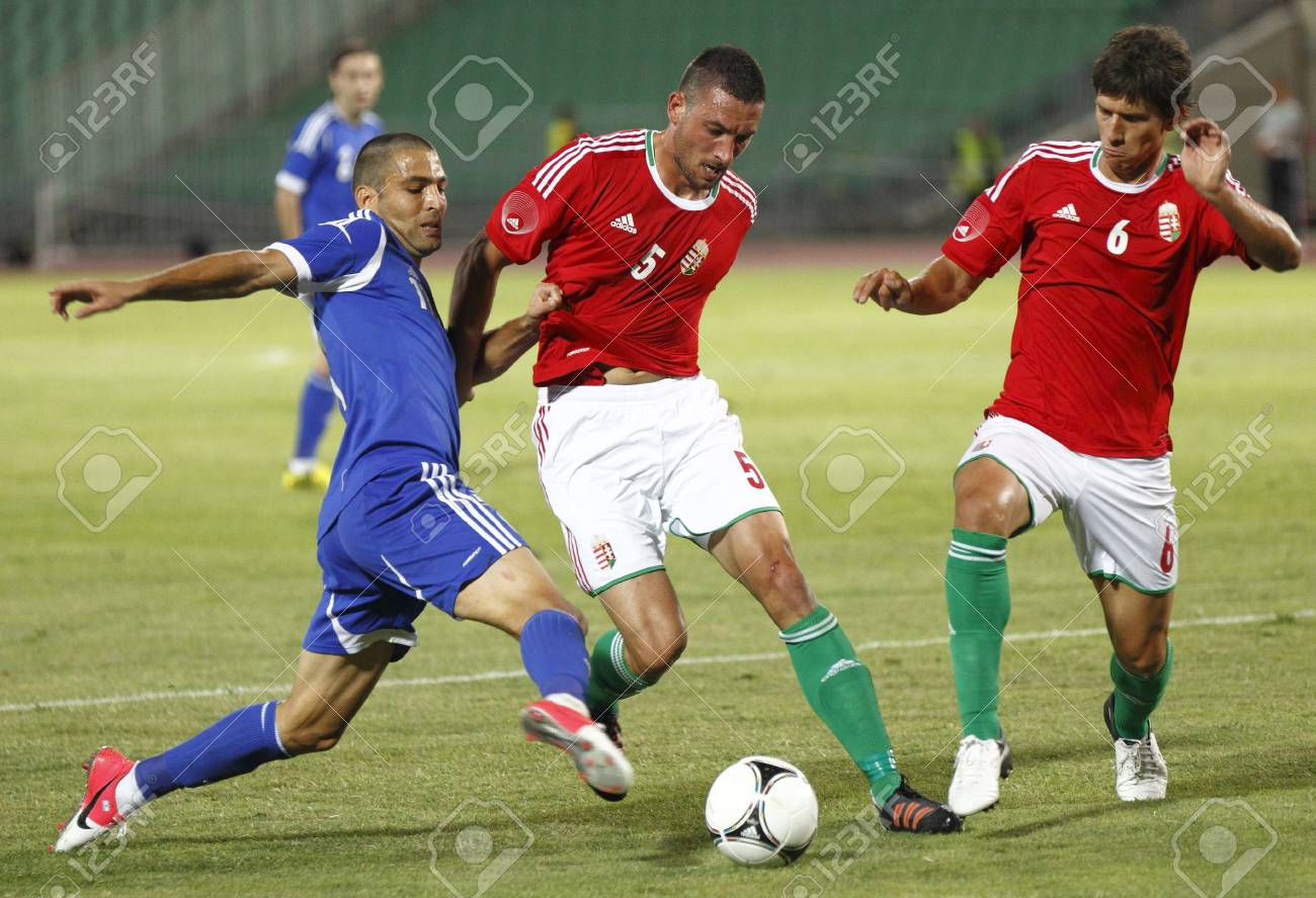 BUDAPEST - August 15: Hungarian Laczko (6) and Meszaros (5), and Israeli Shechter during Hungary vs. Israel friendly football game at Puskas Stadium on August 15, 2012 in Budapest, Hungary. Stock Photo - 14817771