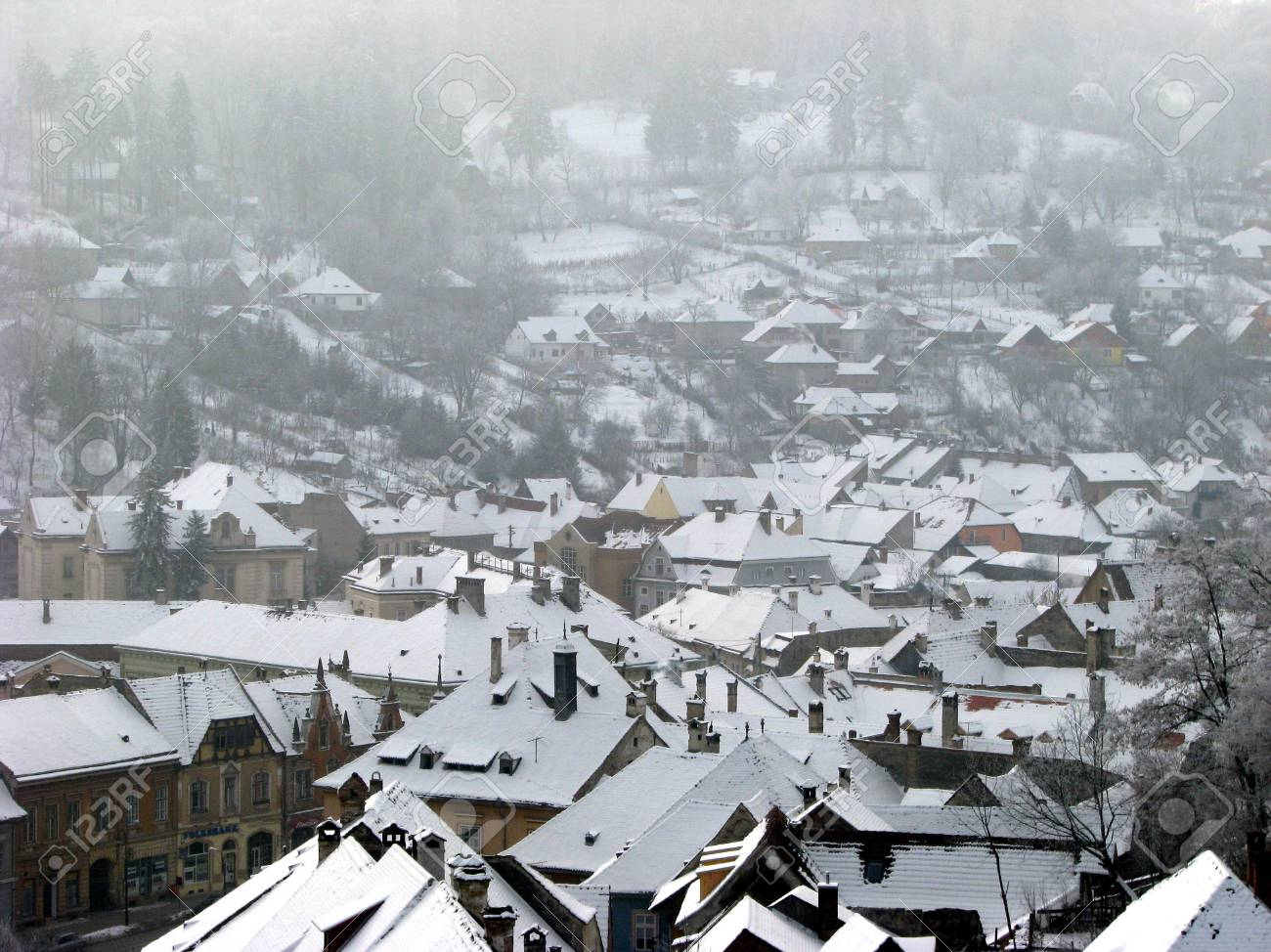 snowy roofs in winter village Stock Photo - 2307704