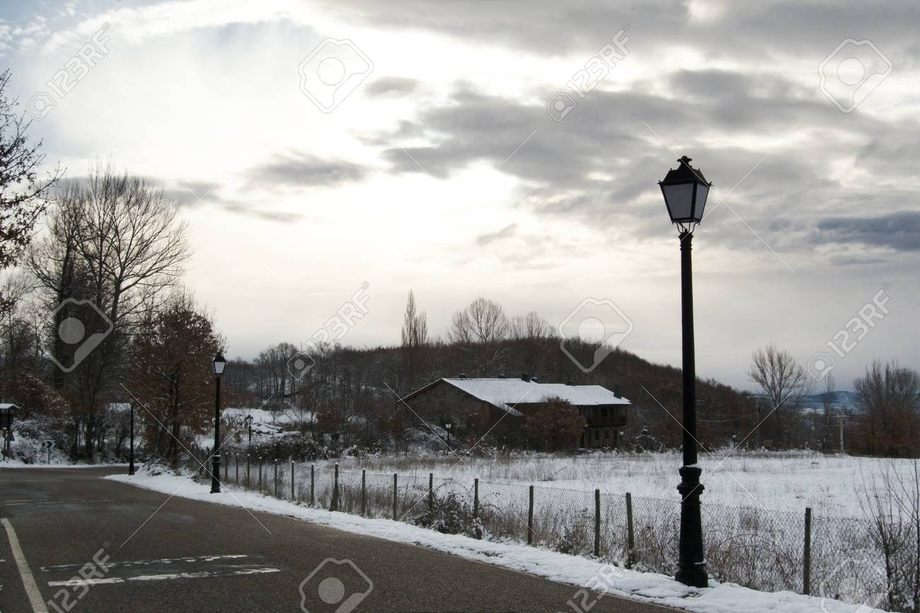 Public lamp by sunrise at countryside covered with snow Stock Photo - 12871050
