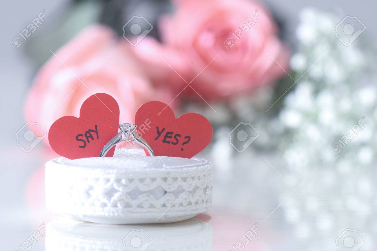 Marriage Proposal Ring With Roses In Background Stock Photo, Picture ...