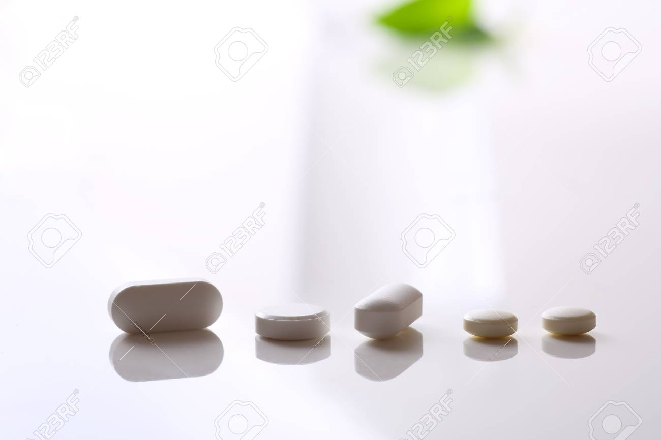 many tablets on white background - 85340357