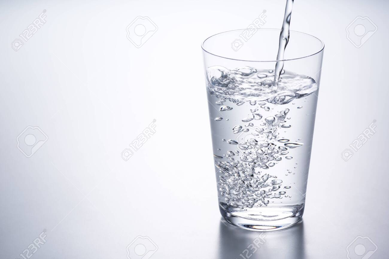 pouring water into glass - 120554863