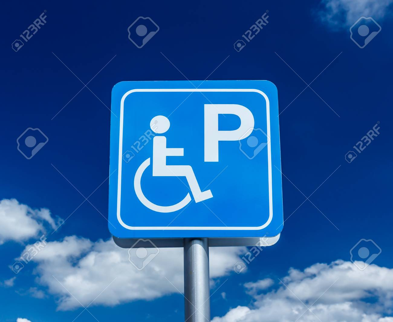 - The Disabled Parking Sign On A White Background. Stock Photo