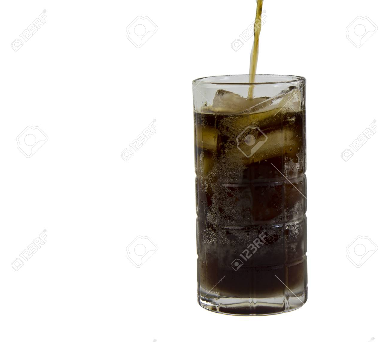 Freshly Poured Soda On Ice In Clear Glass