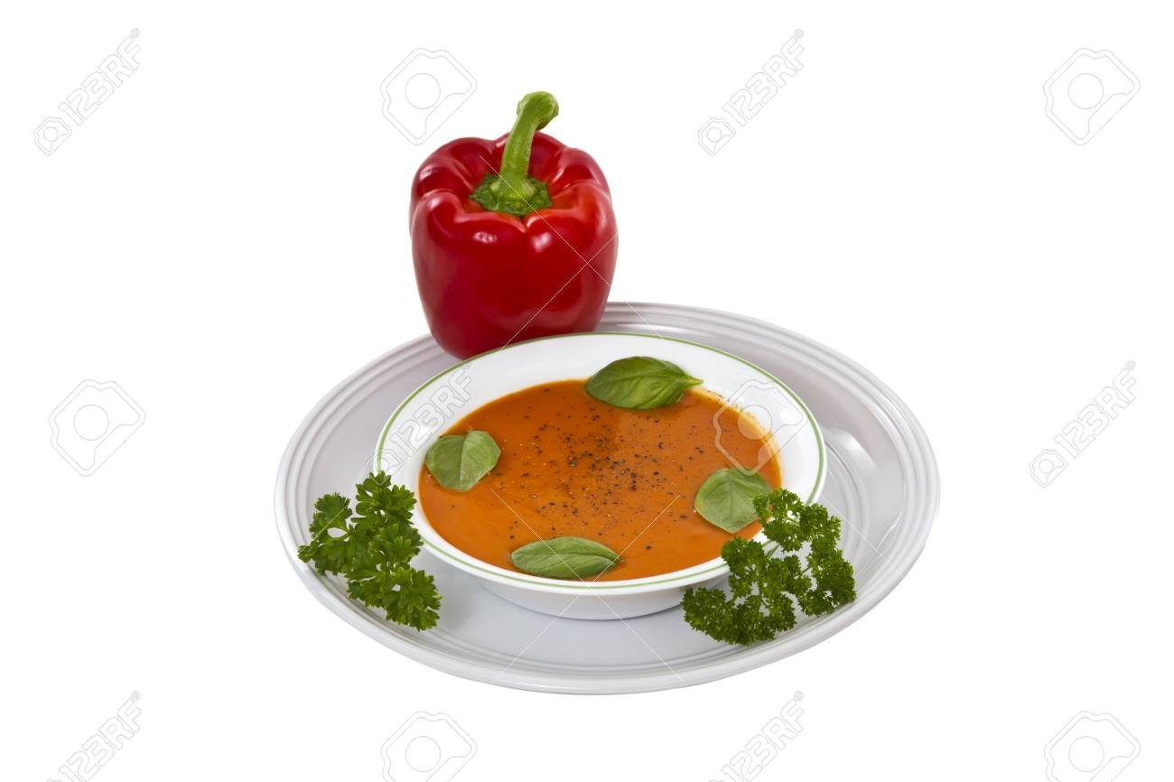 Fresh basil tomato soup in bowl with plate on white background Stock Photo - 9903871