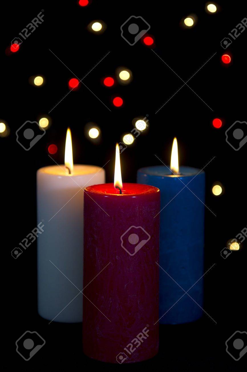 Colorful Candles In White Red Blue On Black Background With