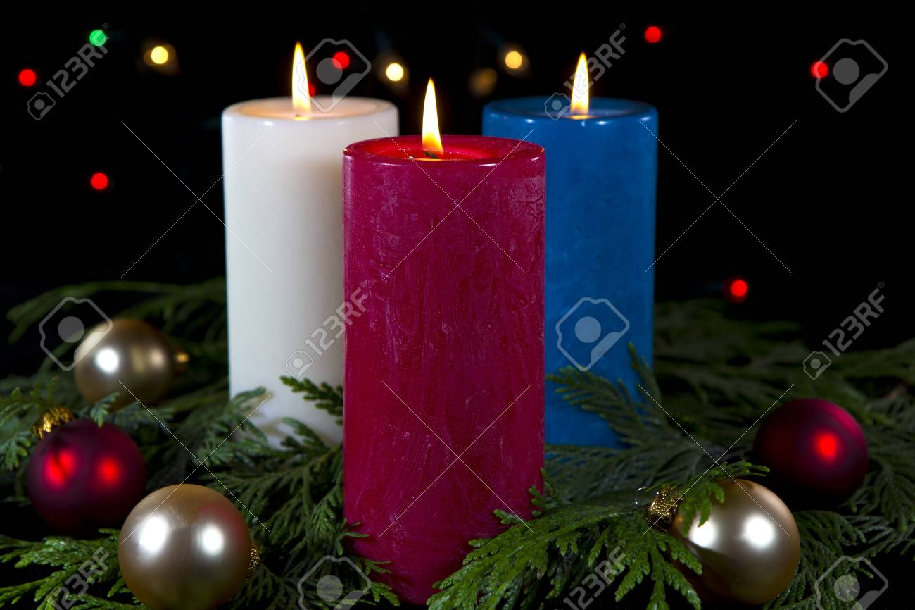 Colorful Candles In White Red Blue In Seasonal Setting On Black