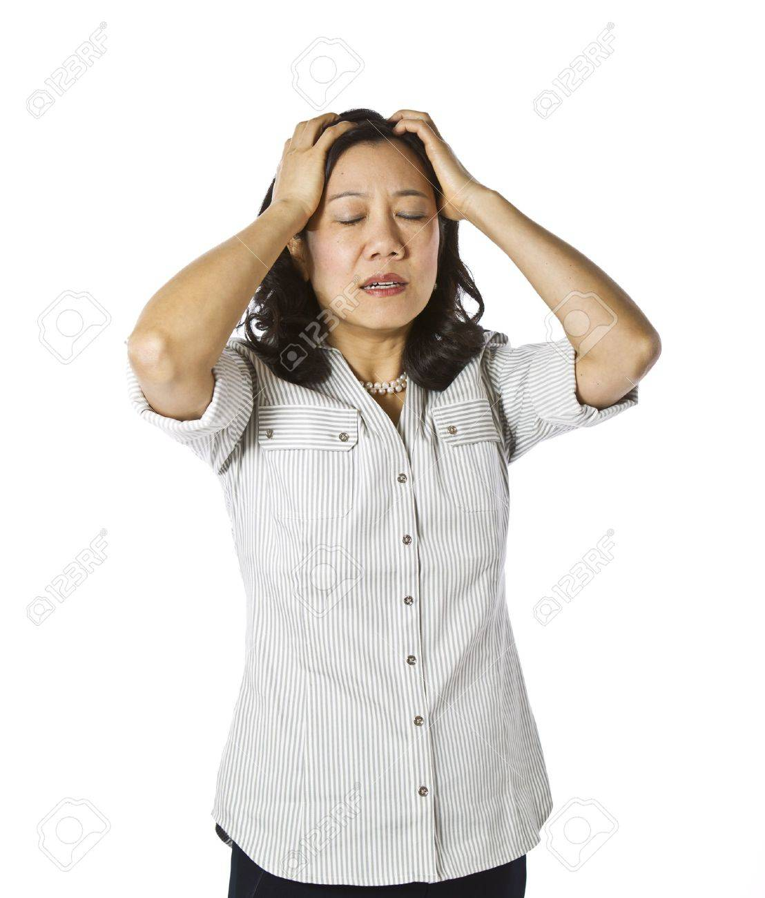 Asian women expressing frustration dressed in casual work clothing on white background Stock Photo - 12178485
