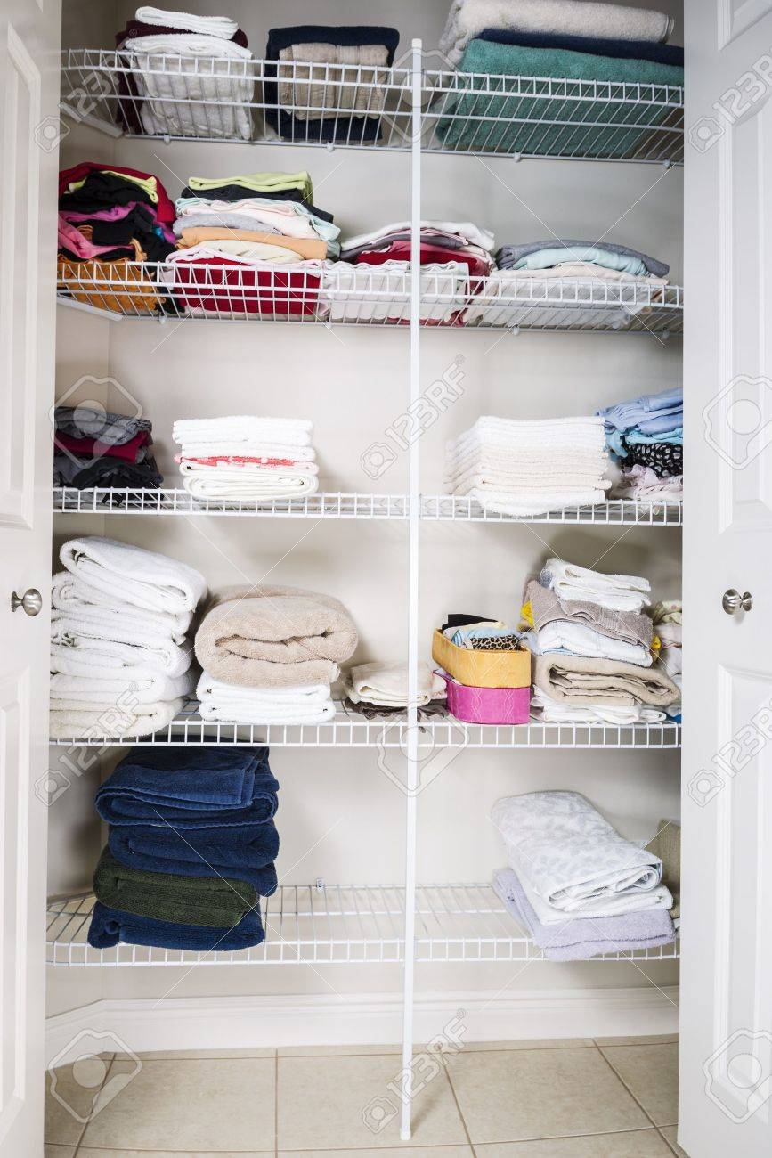 clean and organized bathroom closet with towels on shelves Stock Photo - 14965672