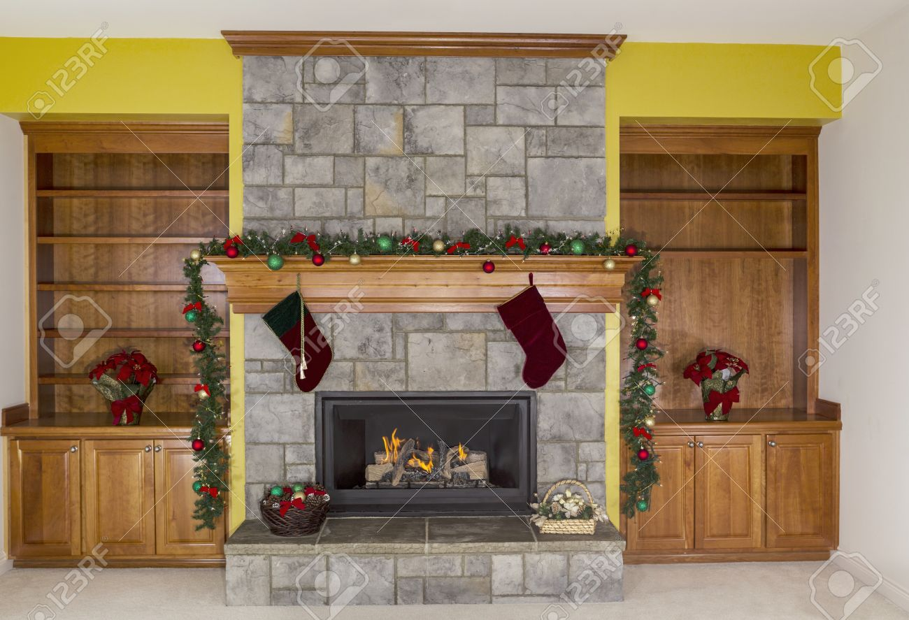 large natural gas fireplace decorated for the holidays with accent