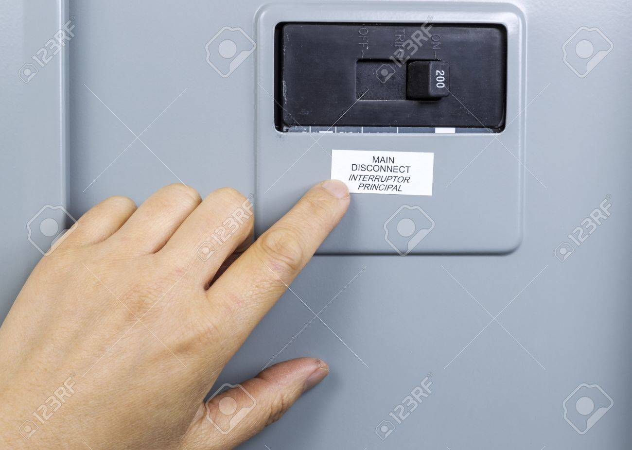 Female hand near main circuit breaker of house power panel Stock Photo - 16587612