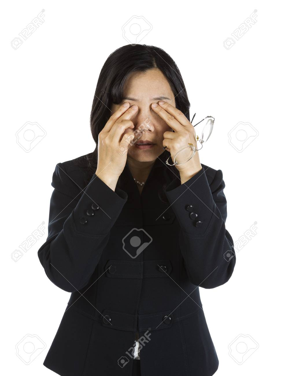 Mature Asian Woman rubbing eyes and holding glasses on white background Stock Photo - 16711067