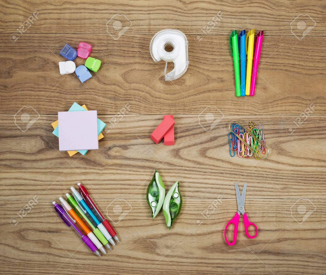Overhead View Of Office Supplies Placed On Rustic Wood Items Include Hanging  Clips, Tape