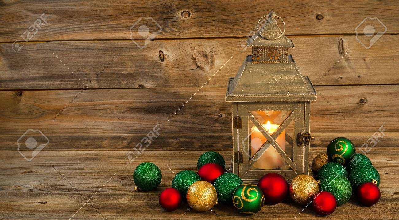 Asian christmas ornaments - Horizontal Front View Of An Old Asian Design Lantern And White Candle Glowing Brightly Inside With