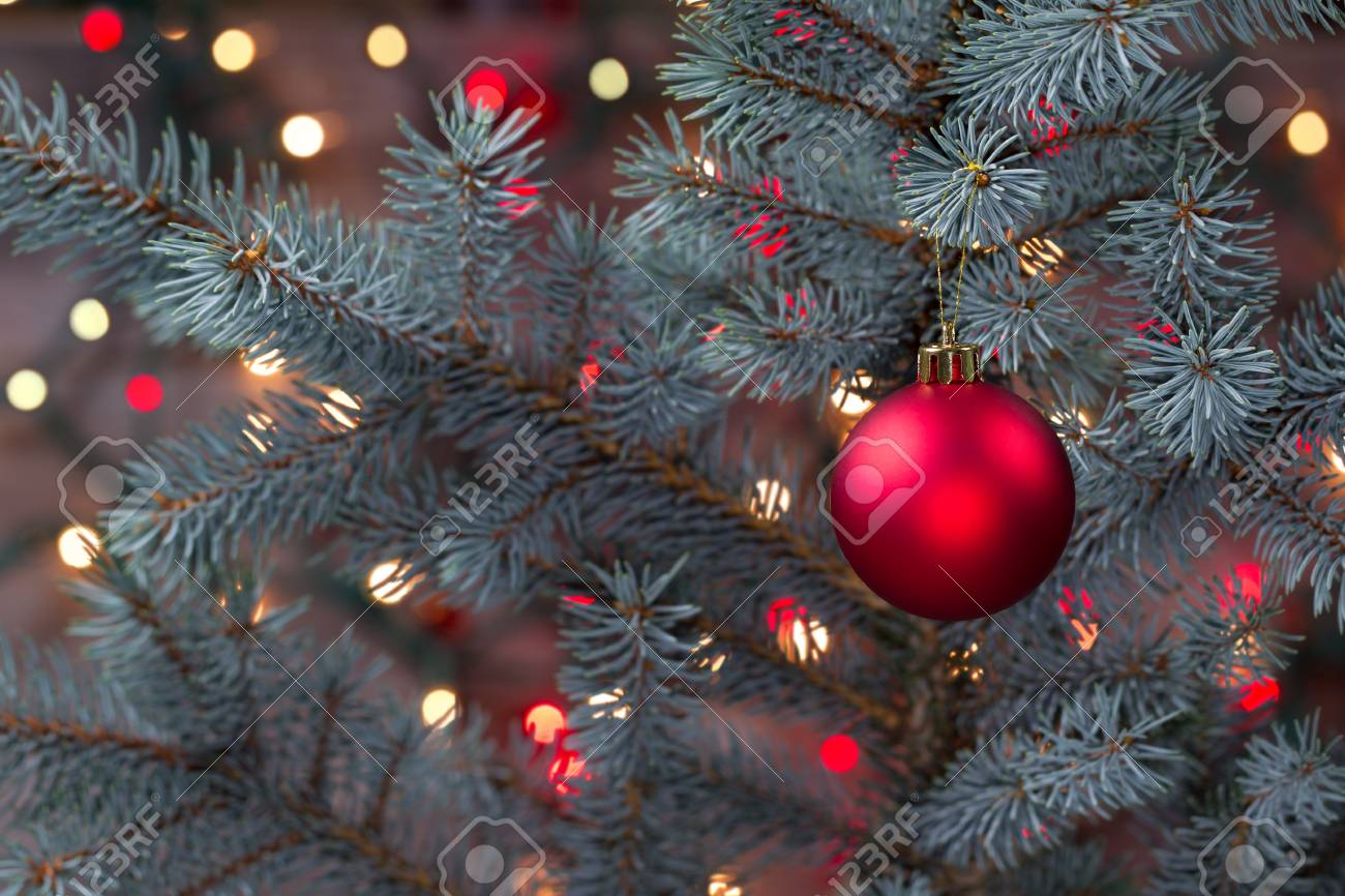 Closeup Horizontal Image Of A Single Red Christmas Ornament Hanging