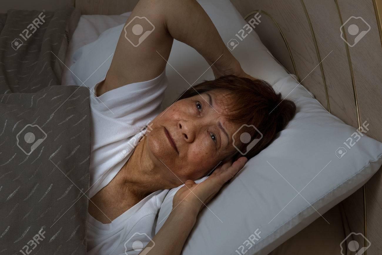 Close Up Of Senior Woman, Eyes Open Looking Upward, Trying To Fall Asleep